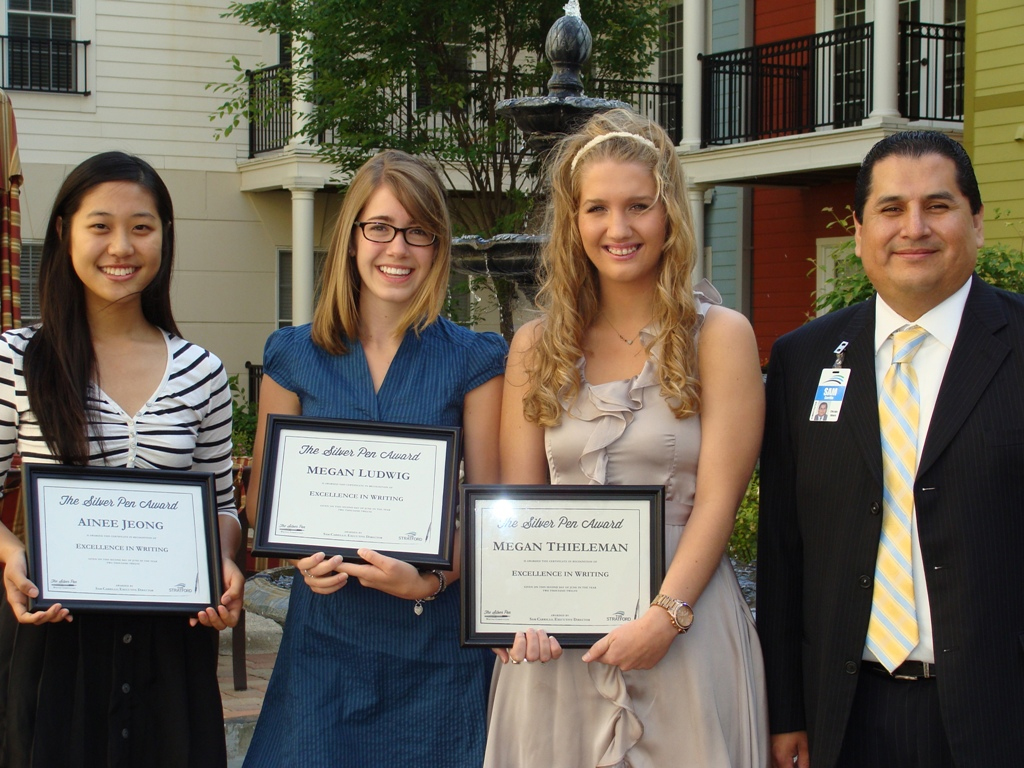 Winners of The Silver Pen Scholarship pose with The Stratford's Executive Director Sam Carrillo. Pictured (from left to right) are: Ainee Jeong, Megan Ludwig, Megan Thieleman and Executive Director Sam Carrillo. (First place winner Shaina Pan was out of the country at the time of the photo).