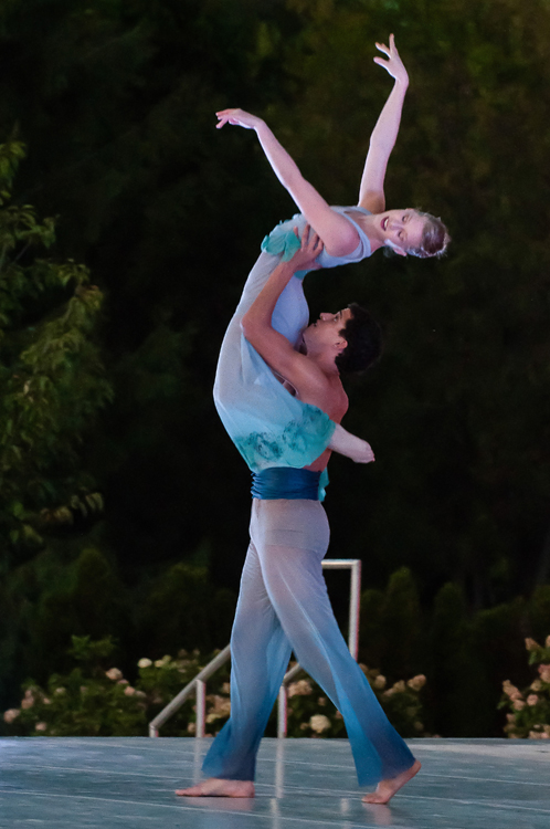 Two dancers execute a lift during the performance.