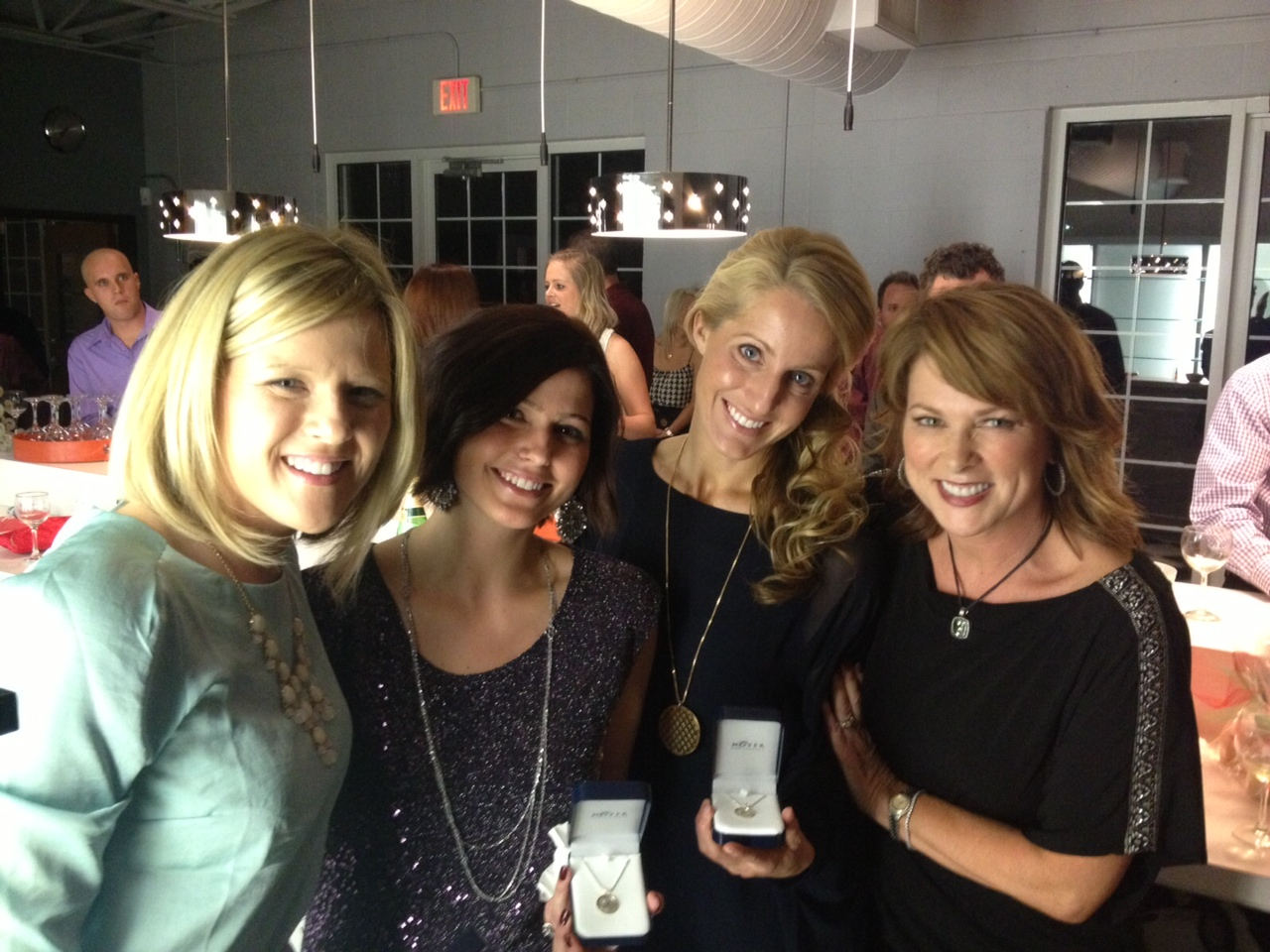 From left, Stylists Molly Vaught and Angela Bloehs, Vice President of Operations Christi Thompson and Owner Micki Stirsman