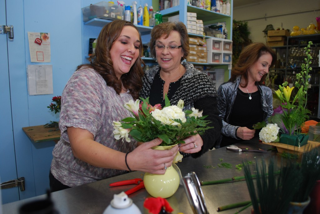 From left, Kristen Weiss, Becky Weiss and Caren Goodwin ply their trade at Union Street Flowers & Gifts in downtown Westfield. (Photo by Robert Herrington)