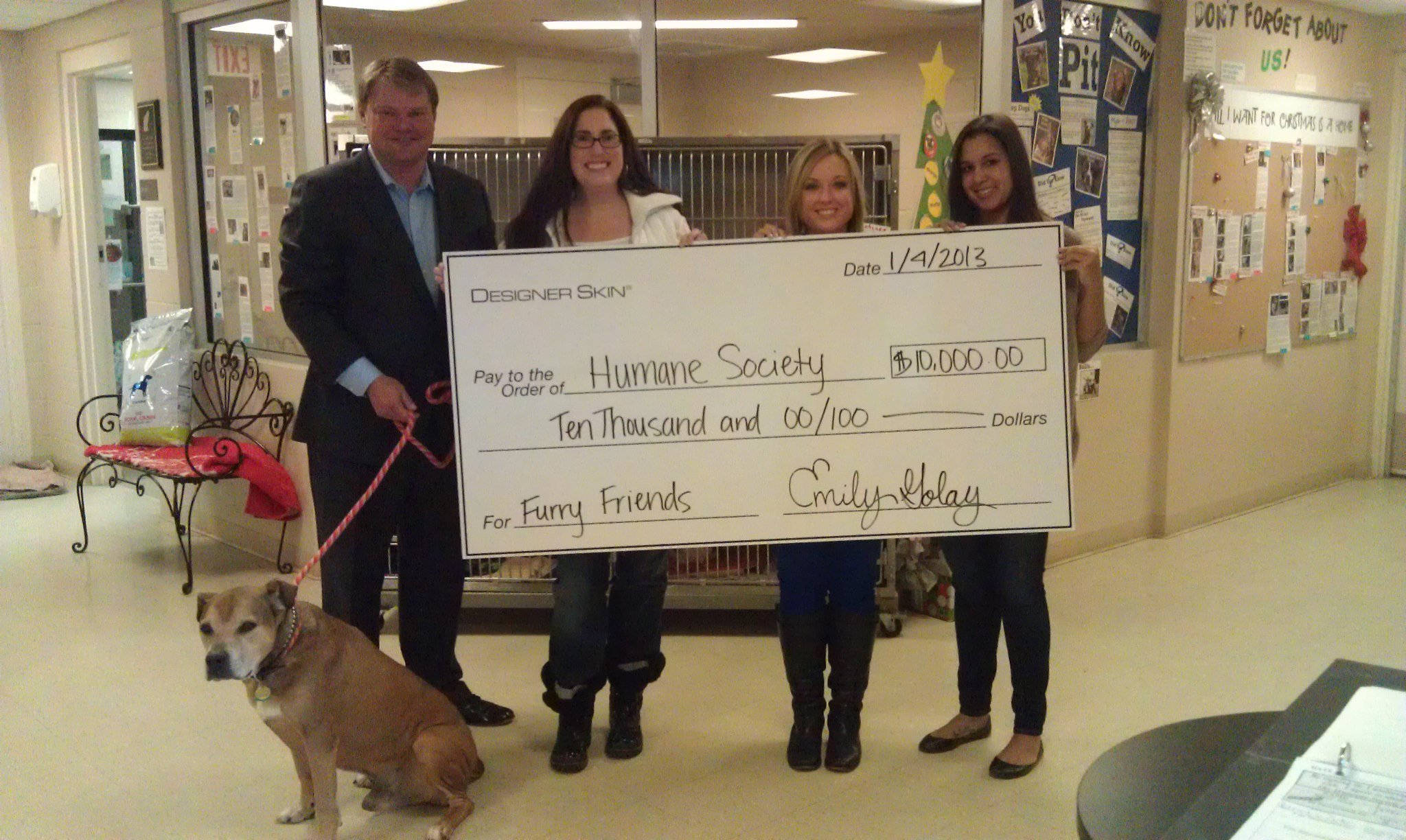 From left: Scott Matthews of New Sunshine, Humane Society for Hamilton County Executive Director Rebecca Stevens, and Emily Golay and Hillary Hammond of Designer Skin. (Photo provided by Humane Society of Hamilton County)