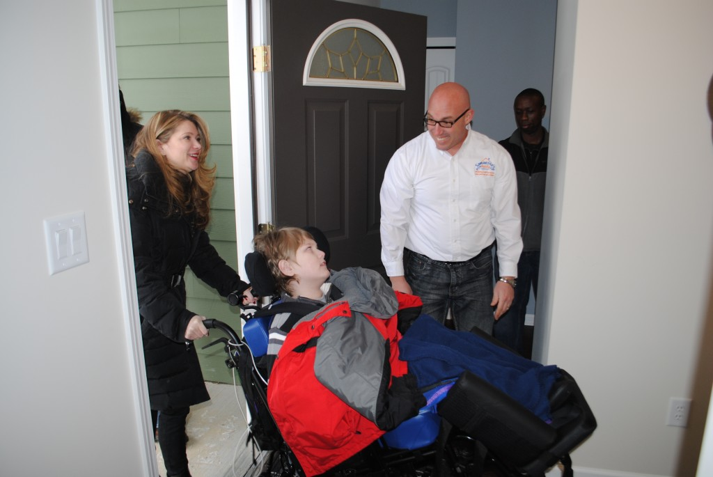 y and Jackson Miller were welcomed into their new home by Samantha's House Executive Director James Keller.