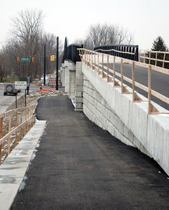 Handrails, a second layer of asphalt and a little site work are needed to finish the Monon Pedestrian Bridge on 146th Street. (Photo by Robert Herrington)