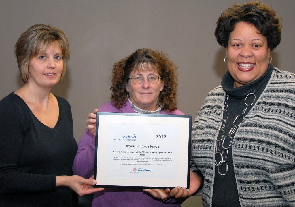 Sodexo Food Service employees Linda McCoy, Susan Luther and Beverly Goza Holmes proudly display the Award of Excellence. Not pictured are the school Café' employees who greatly contributed to the team receiving the award. (Photo submitted by Tenna Pershing)