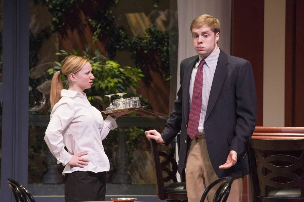 Justin (Geoffrey McKinney) explains to Louise (Melissa Mellinger) how he got his new job at Quail Valley Country Club.