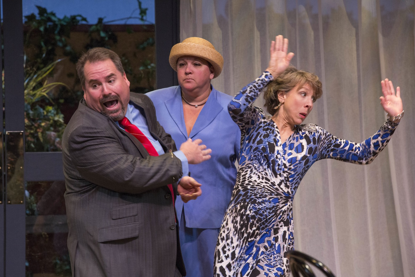 Muriel (Lynda Goeke) catches her husband Bingham (Parrish Williams) and Pamela (Jean Childers-Arnold) in an embarrassing moment.
