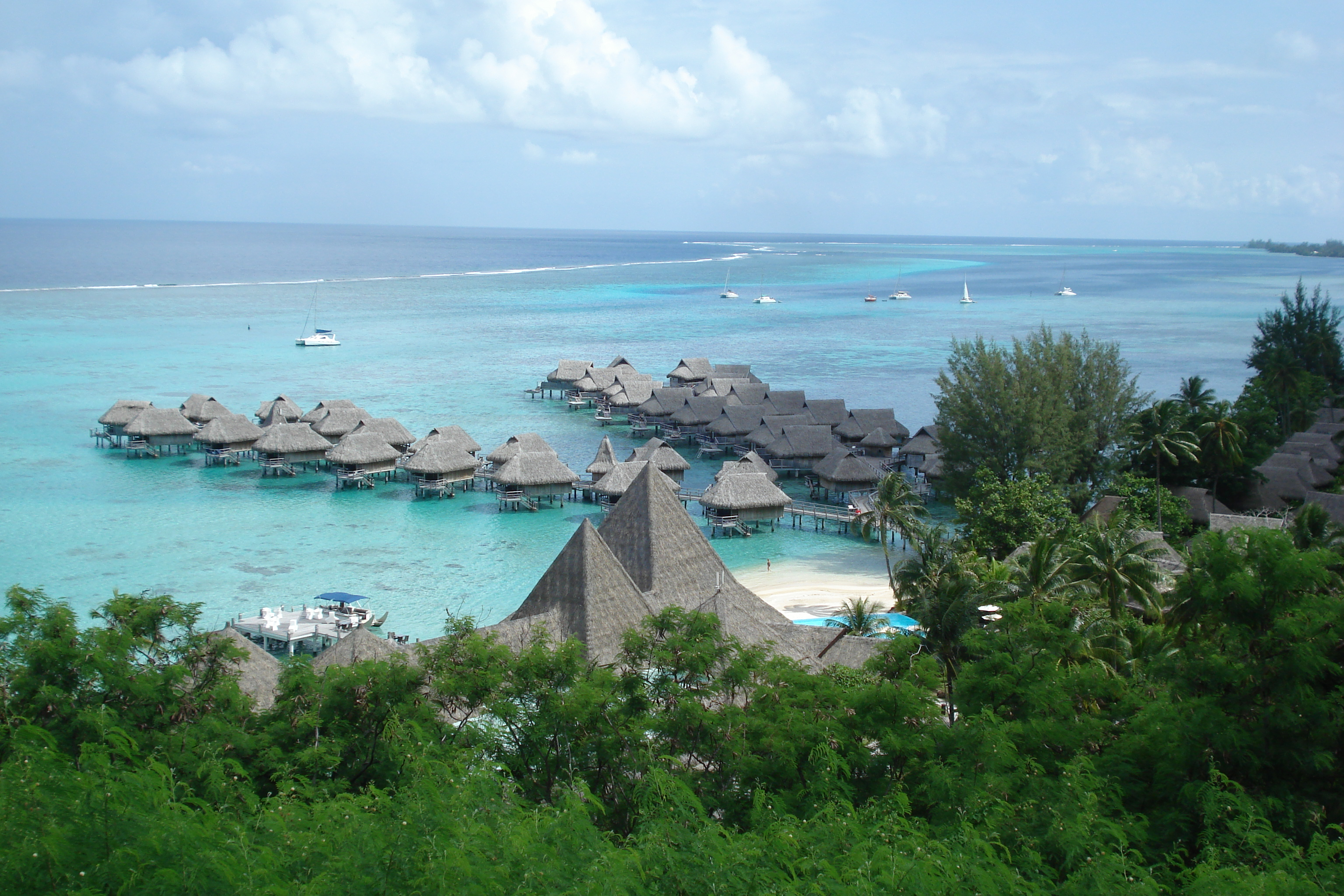 Bungalows line the beach in Moorea.