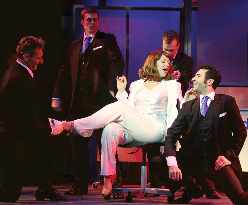 """Violet Newstead (Annie Edgerton), center, enjoys the idea of being a female CEO and """"One of The Boys"""" in 9 to 5, The Musical."""