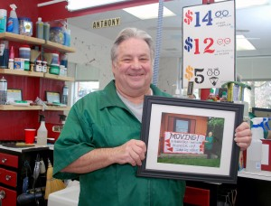 Tony Laurenzana holds of photo a customer took of him at the old shop.