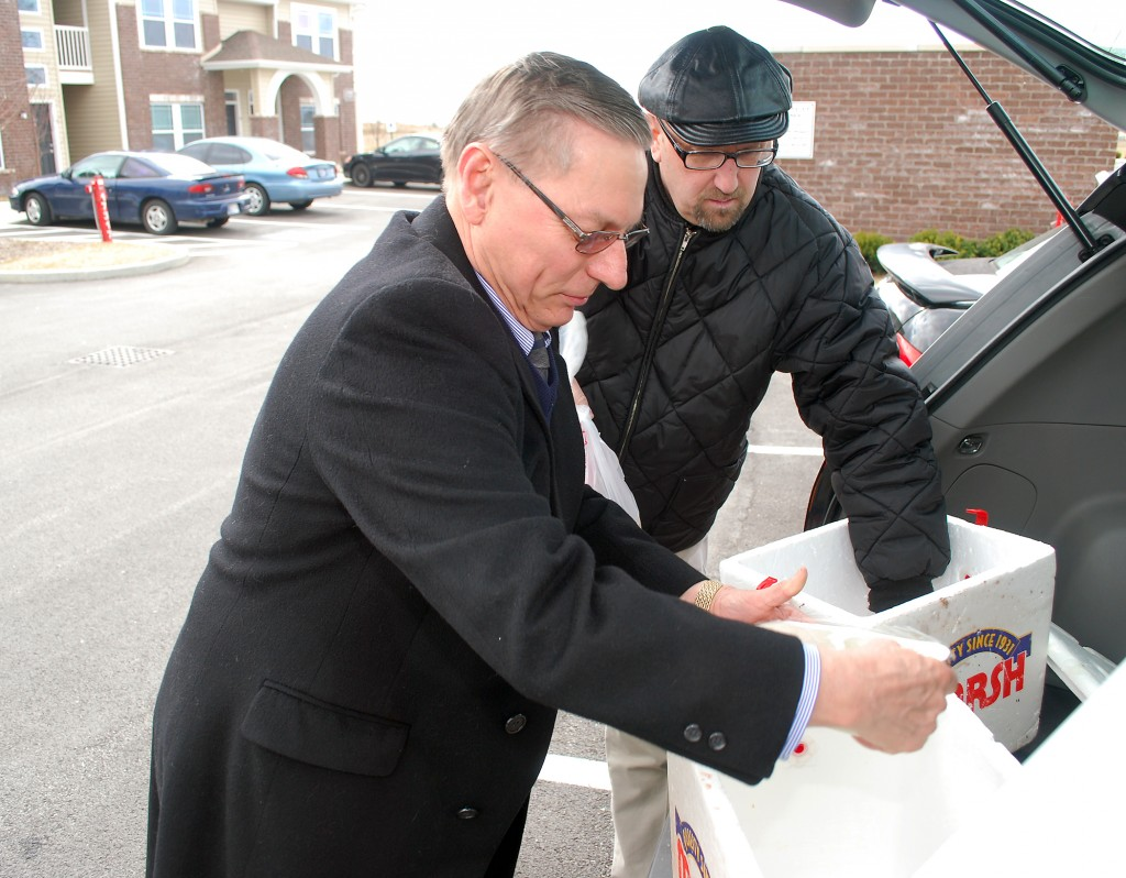 Westfield City Council President Jim Ake, left, and Meals on Wheels volunteer Greg Flood prepare two deliveries.