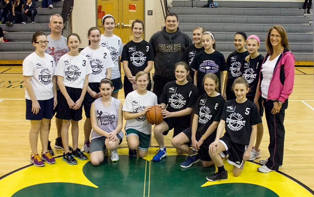 The two winning teams from Student Impact middle school girls basketball and their respective coaches.   (Photo provided by Danyele Easterhaus)