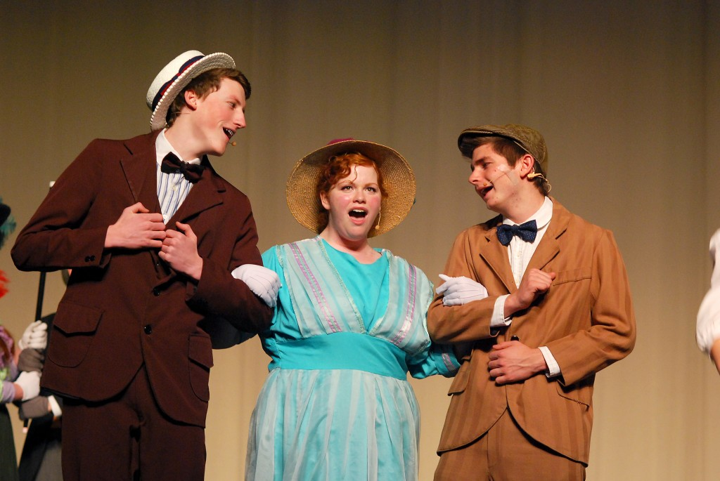 """Cornelius Hackl (Craig Thompson), Dolly Levi (Anna Christianson) and Barnaby Tucker (Nathan Fauntleroy) sing """"Put on [their] Sunday Clothes"""" and board a train to New York. (Photos by Robert Herrington)"""