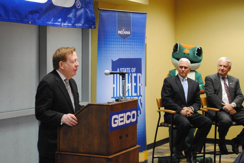 From left, Mayor Jim Brainard, Governor Mike Pence, the GEICO Gecko and GEICO Chairman Tony Nicely. (Photo by Christian Sorrell)