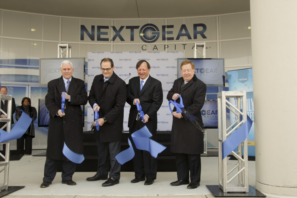 From left, Indiana Governor Mike Pence, NextGear Capital President Brian Geitner, Manheim President Sandy Schwartz and Carmel Mayor Jim Brainard cut the ribbon. (Submitted photo)