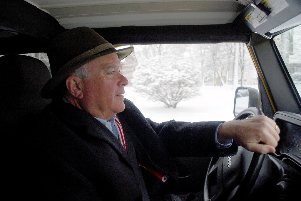 Mayor Andy Cook drives the streets of Westfield in his yellow Jeep looking to assist in the city's plowing efforts.