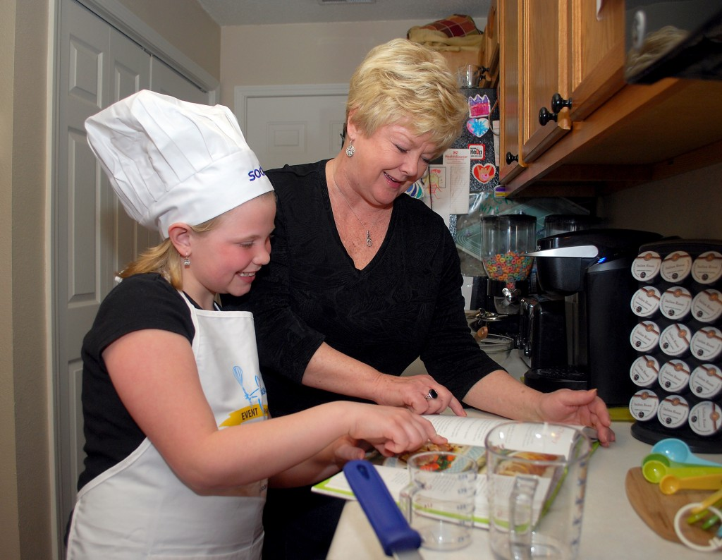 Lana Reinking and her grandmother, Sheryl Warner, look at a recipe in a cookbook she received as the Westfield Washington Schools Future Chef winner. (Photo by Robert Herrington)