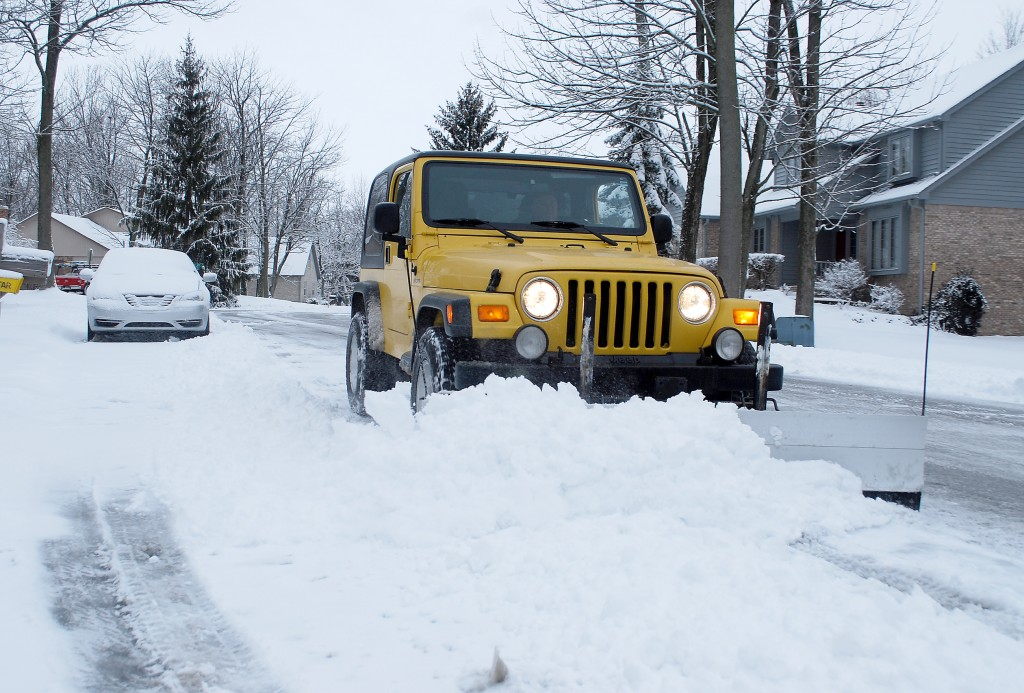 Westfield Mayor Andy Cook takes civic service to the next level as he drives his Jeep and plow through city streets helping to clear snow in the morning hours of March 6. (Photos by Robert Herrington)