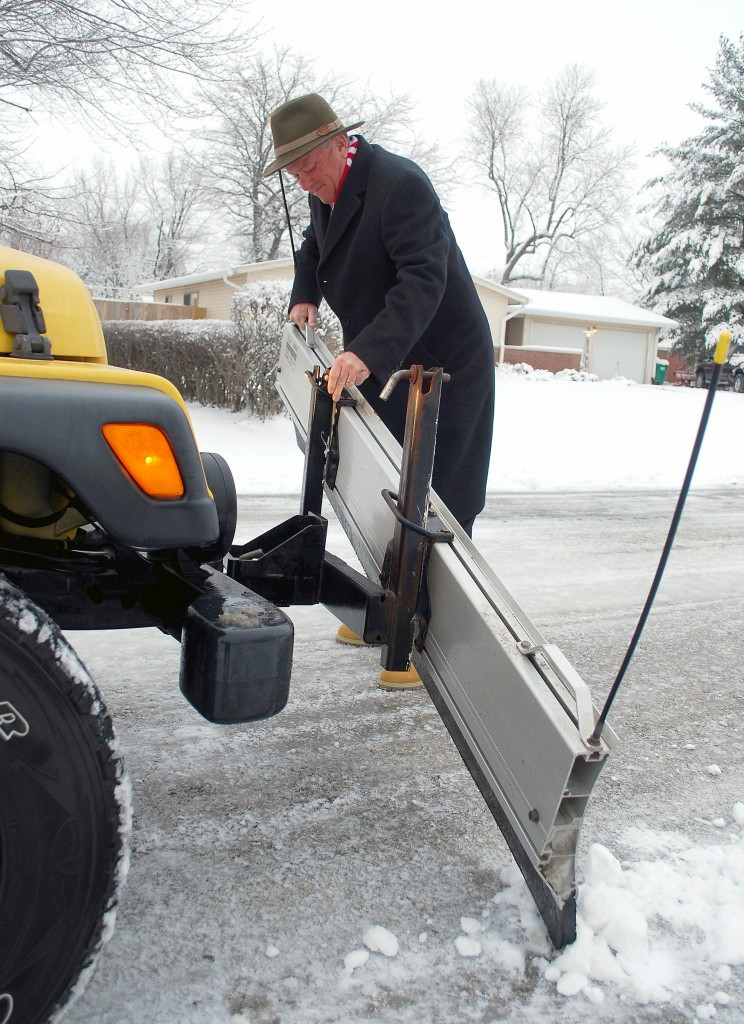 Unlike the hydraulic blades on the city trucks, the plow on Mayor Andy Cook's Jeep has to be lowered and lifted manually.