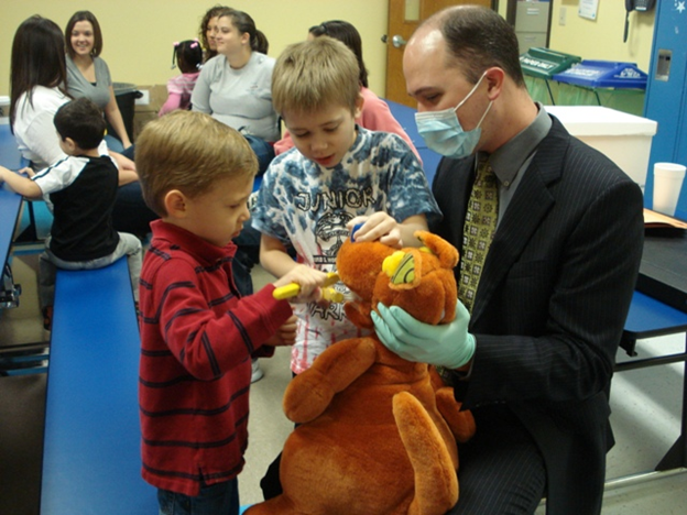 Dr. Kevin Beadle shows Little Star Learners healthy toothbrush habits. (Submitted photo)