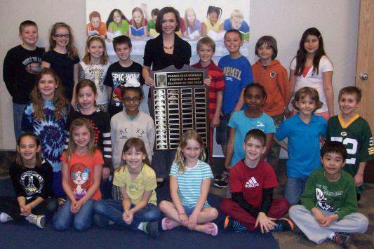 White accepting the Teacher of the Year award alongside her third-grade class. (Submitted photo)