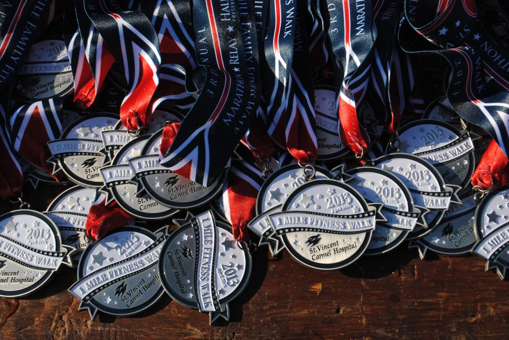 Several tables were covered with medals for all of the day's events in preparation for the runners' return.