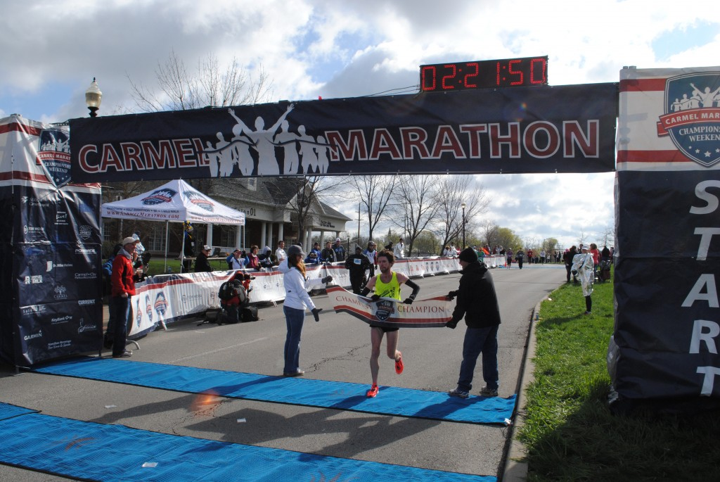 Jesse Davis catching the banner as he takes first place at this year's marathon.