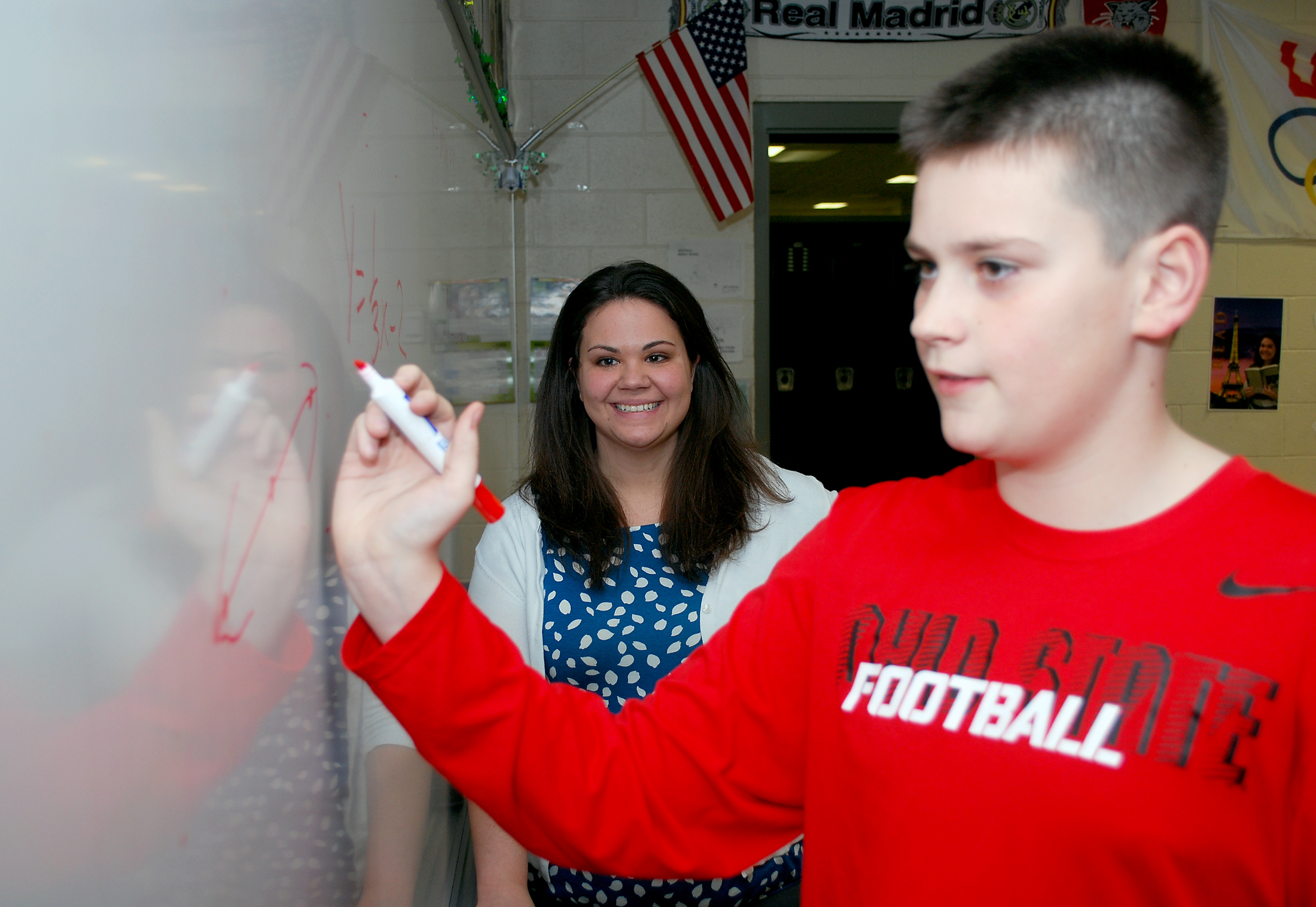 Kelly Day watches as seventh-grade student Michael Koza works on a math equation.