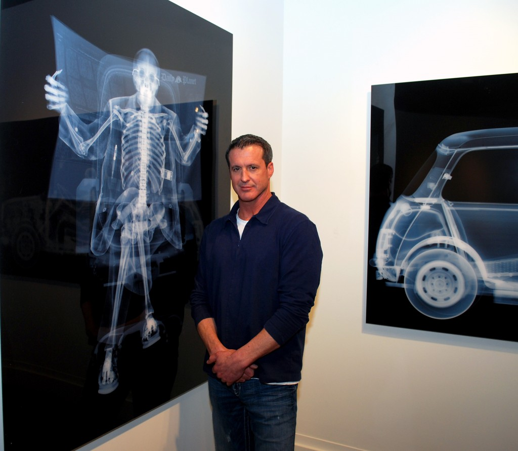 Evan Lurie, owner of Evan Lurie Fine Art Gallery, with pieces by artist Nick Veasey.