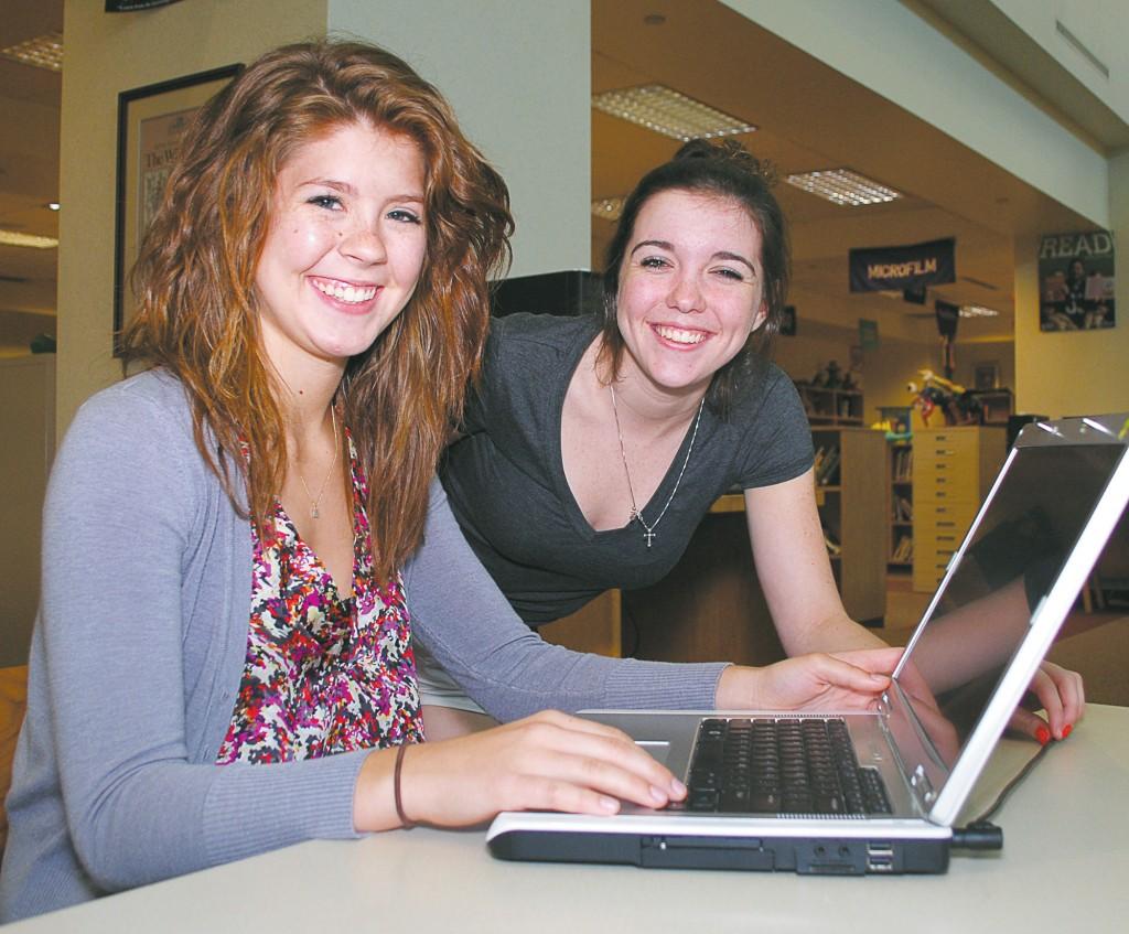Lauren Huser, left, and Shannon Webb created the Volunteer Network as their Westfield High School Executive Committee project. (Photo by Robert Herrington)