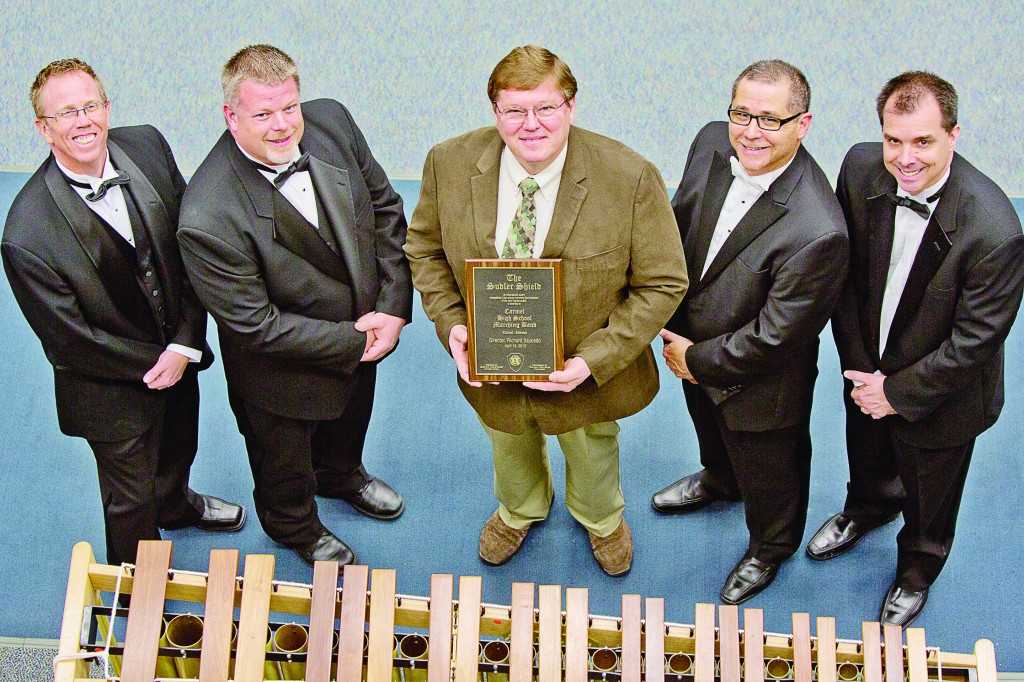 Left to right: Carmel High School's Andrew Cook, associate director of bands; Chris Kreke, head marching band director and associate director of bands; Greg Bimm, committee member; John Philip Sousa Foundation; Richard Saucedo, director of bands; and Michael Pote, associate director of bands. (Submitted photo)