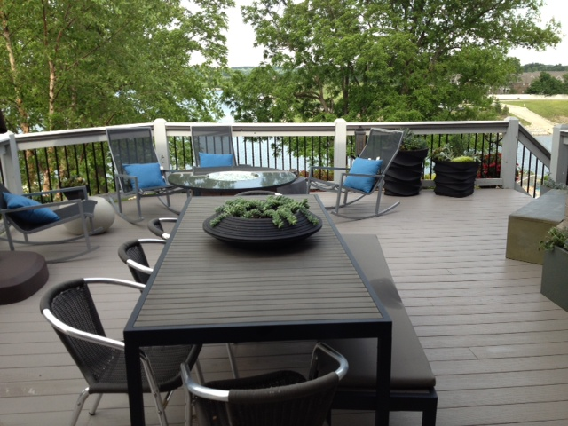 Dark plastic decking with a white railing makes this deck feel more like a custom piece of furniture than a dated outdoor space. (Photo submitted.)