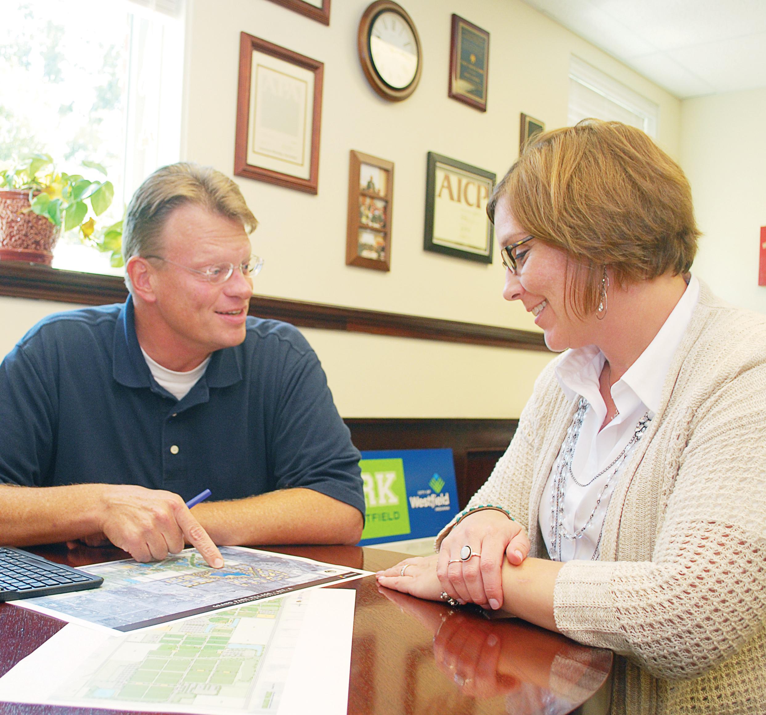 Westfield Economic and Community Development Director Matt Skelton looks over plans with Assistant Director Jennifer Miller in his office. (Photo by Robert Herrington)