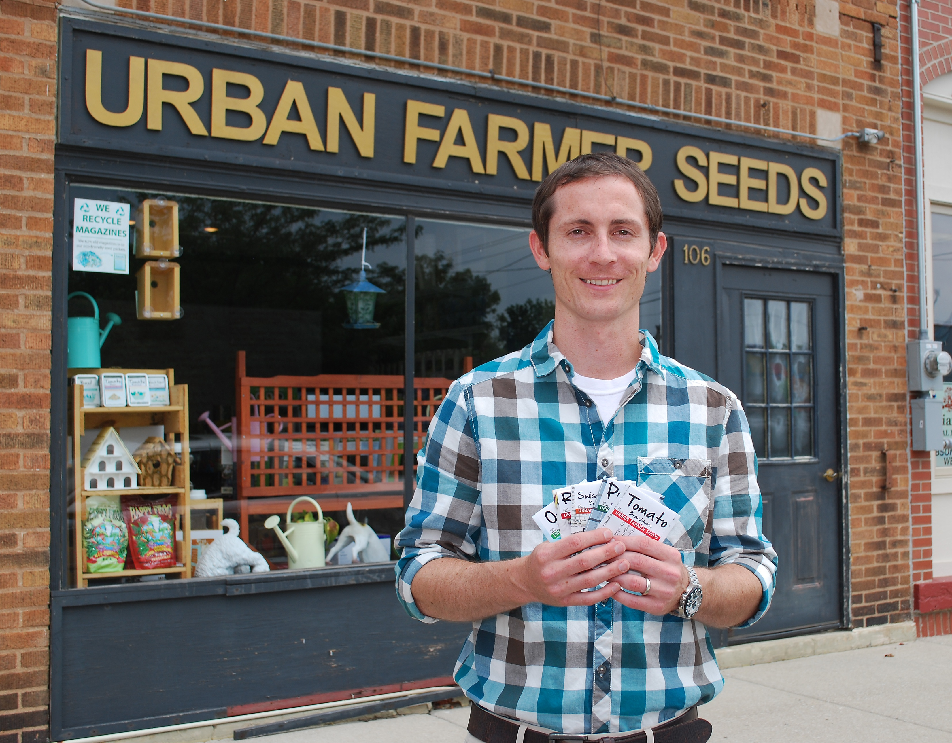 Noah Herron used recycled magazines to start his gardening business, Urban Farmer Seeds. (Photos by Robert Herrington)