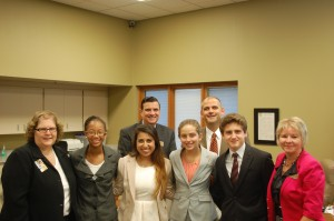 The team put on a demonstration for the HSE School Board and audience members at its Aug. 26 meeting. From (front) left, Janet Chandler, Kaia Thompson, Sherisa Abbaspour, Natalie Teyema, Nick Iacobucci, HSE School Board President Diane Eaton. Back: Supt. Dr. Brian Smith and HSEHS Principal Matt Kegley.