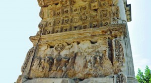A relief in the Arch of Titus shows Roman troops hauling items looted from the Second Temple. Historians now believe a layer of gold originally covered the plunder shown in the relief. (Submitted photo)