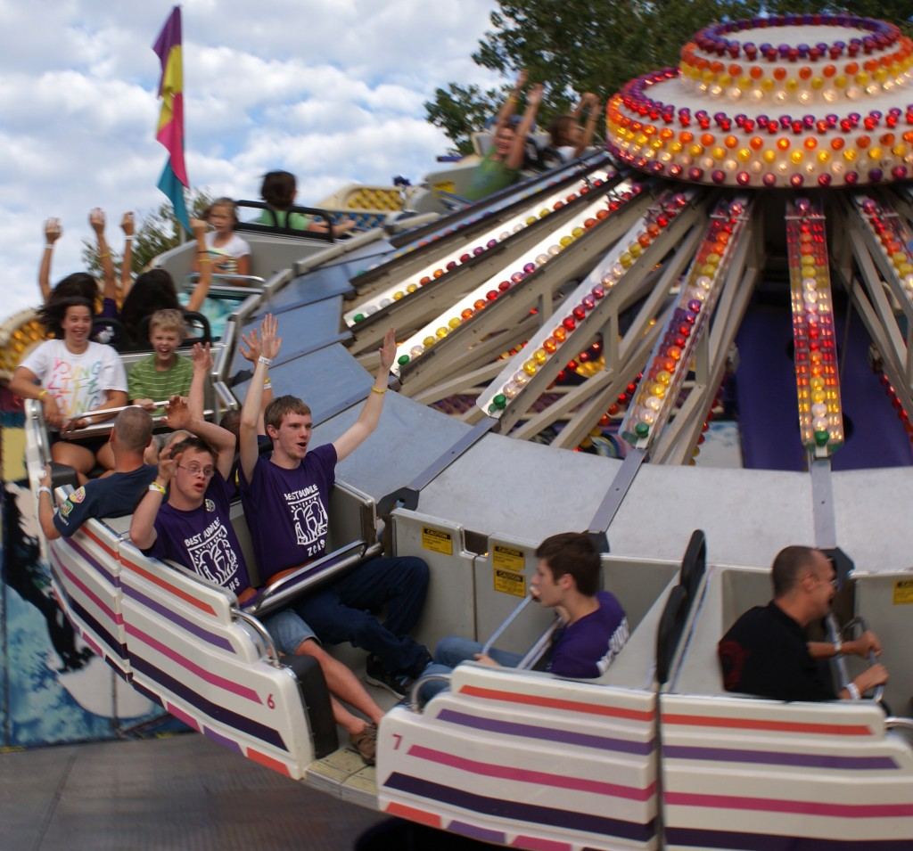 """Since 2008, """"Very Important People"""" enjoy a carnival ride during a Friday-night Fall Festival kick-off event. (Submitted photos)"""