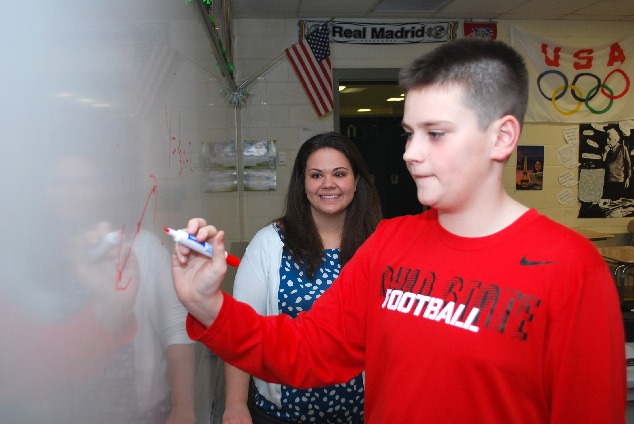 Westfield Middle School teacher Kelly Day watches as Michael Koza works out  a math problem.