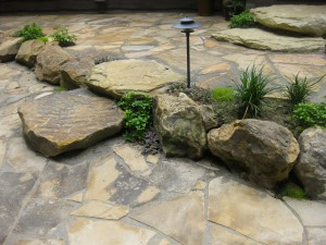 Marrying rock elements found around this Turkey Run home with a dramatic change in the landscape's grade helped resolve both an aesthetic issue as well as a functional one. (Submitted photo)