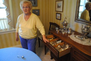 Doreen Squire Ficara, Carmel Arts Council executive director, displays some of the antique silverware that will be used in a fundraiser for arts scholarships. (Staff photo)