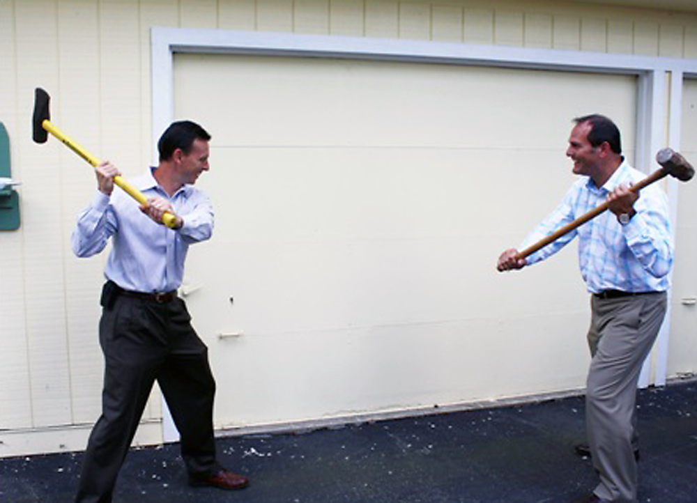 Chaucie's Place board president Jon Kizer and NextGear Capital president Brian Geitner begin the renovations of Chaucie's Place's garage into a training room. Construction should be complete by the end of 2013. (Submitted photo)