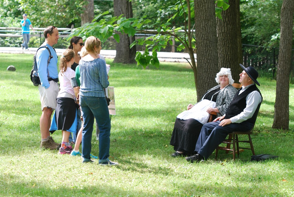 Ambrose (Rich Steinberg) and Elizabeth Osborne (Kate Hinman) share with a Voice from the Past group last year about what it was like to settle in Westfield in 1834. (Photo by Robert Herrington)