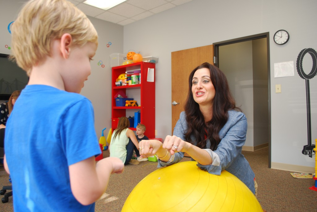 Courtney Bierman works with Crew on his sign language inside the playroom of Bierman ABA Autism Center. The center has just broken ground for a larger facility in Westfield. (Photo by Robert Herrington)