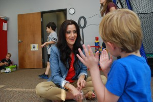 Crew, a student at Bierman ABA Autism Center, claps when asked to before receiving a snack as positive reinforcement by Courtney Bierman.