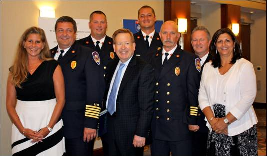 From left: Accreditation Manager Denise Snyder, Fire Chief Matt Hoffman, Section Chief Adam Harrington, Mayor Jim Brainard, Training Chief Steve Frye, Assistant Chief Bob Hensley, Captain Orbie Bowles, and Executive Division Manager Jean Junker at the accreditation ceremony in the Swissotel in Chicago. (Photo submitted)