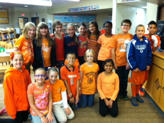 College Wood Elementary School students, front row from left, Flora McKay, Sydney Longstreth, Amber Pietz, Andrew Messner, Charlotte Melby and Nashita Prasad; and back row from left, Alivia Bechert, Anna Koebcke, Yalee Abaiov, Lauren Moon, Caitlin Baudier, Susana Ginella, Viashnavi Raparthi, Jack Ducat, Grant Lipps and Jaedon King wore orange shirts on Oct. 9 as part of Unity Day – where students wear orange to symbolize their anti-bullying stance. (Submitted photo)