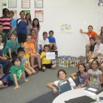 Lisa Kuhn's class at Towne Meadow Elementary School with their classroom donation of 493 cans (and growing). (Submitted photo by Josie McKay.)