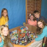From left, Meredith Steever, Isabella Topp, Erin Baker, Reagan Fahey and Quinn Bright from Josie McKay's and Lisa Kuhn's 4/5 challenge classes organizing school-wide food donations. (Submitted photo by Josie McKay.)