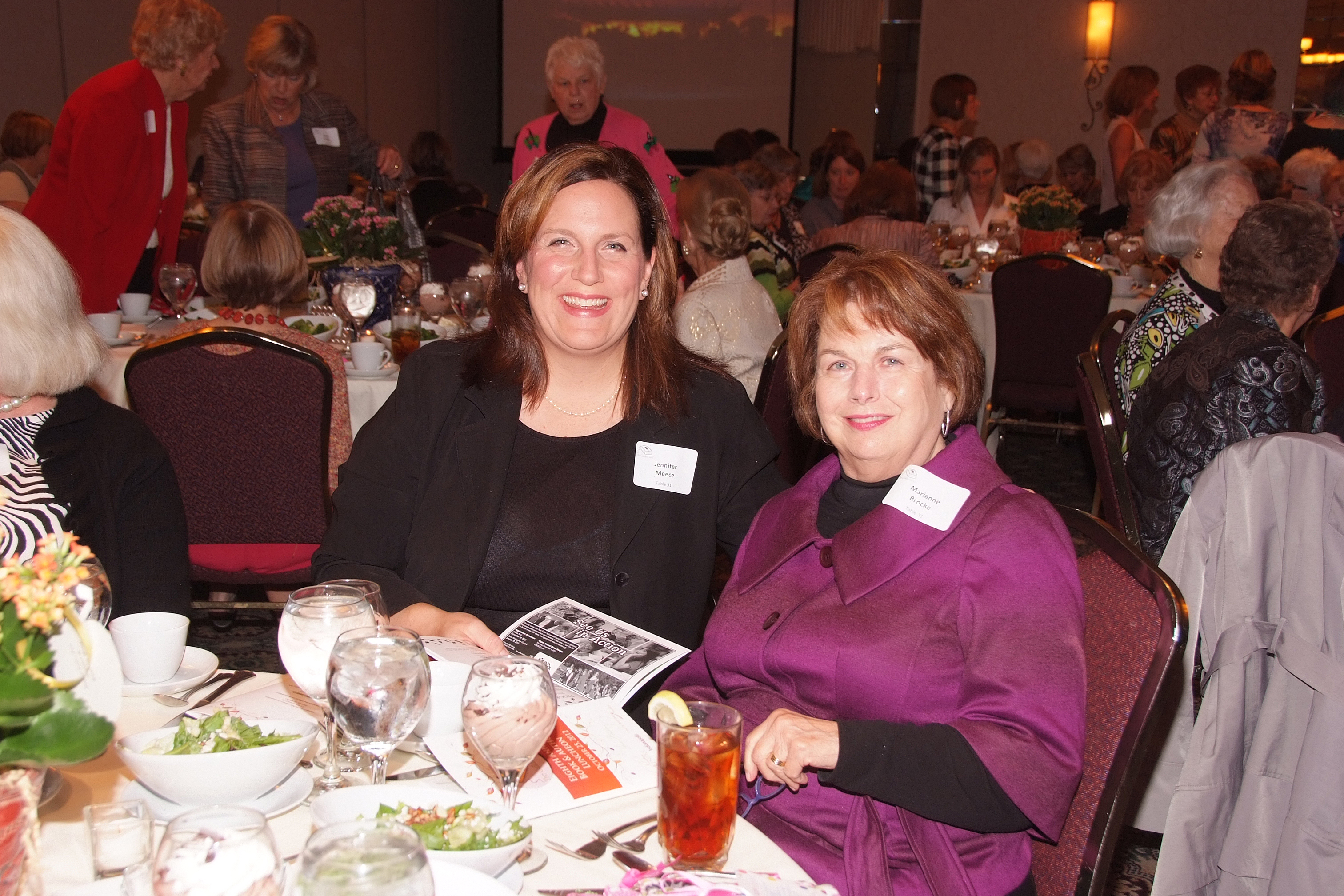 From left, Jennifer Meece and Marianne Brocke enjoyed the food and celebrities at a previous Guilded Leaf Book and Author Luncheon. (Submitted photo)