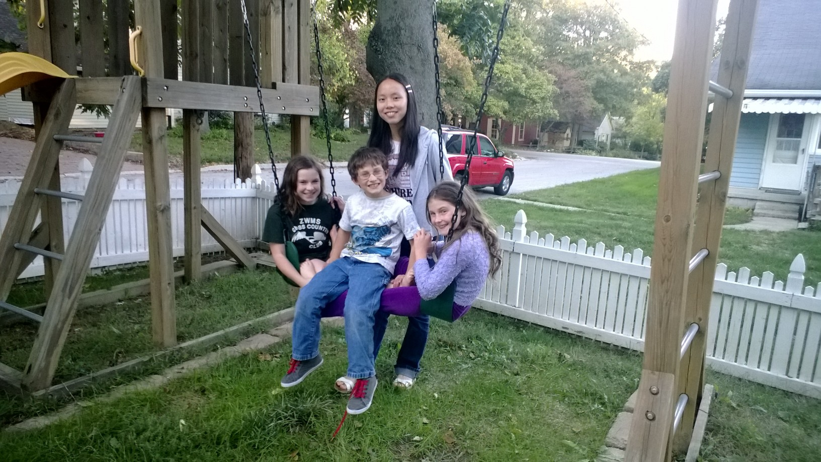 From left, Katie May, Sylvia Qianyu Huang, Zachary May and Kiley May have forged strong bonds through University High School's exchange student program. (Photo by Katy Franz.)