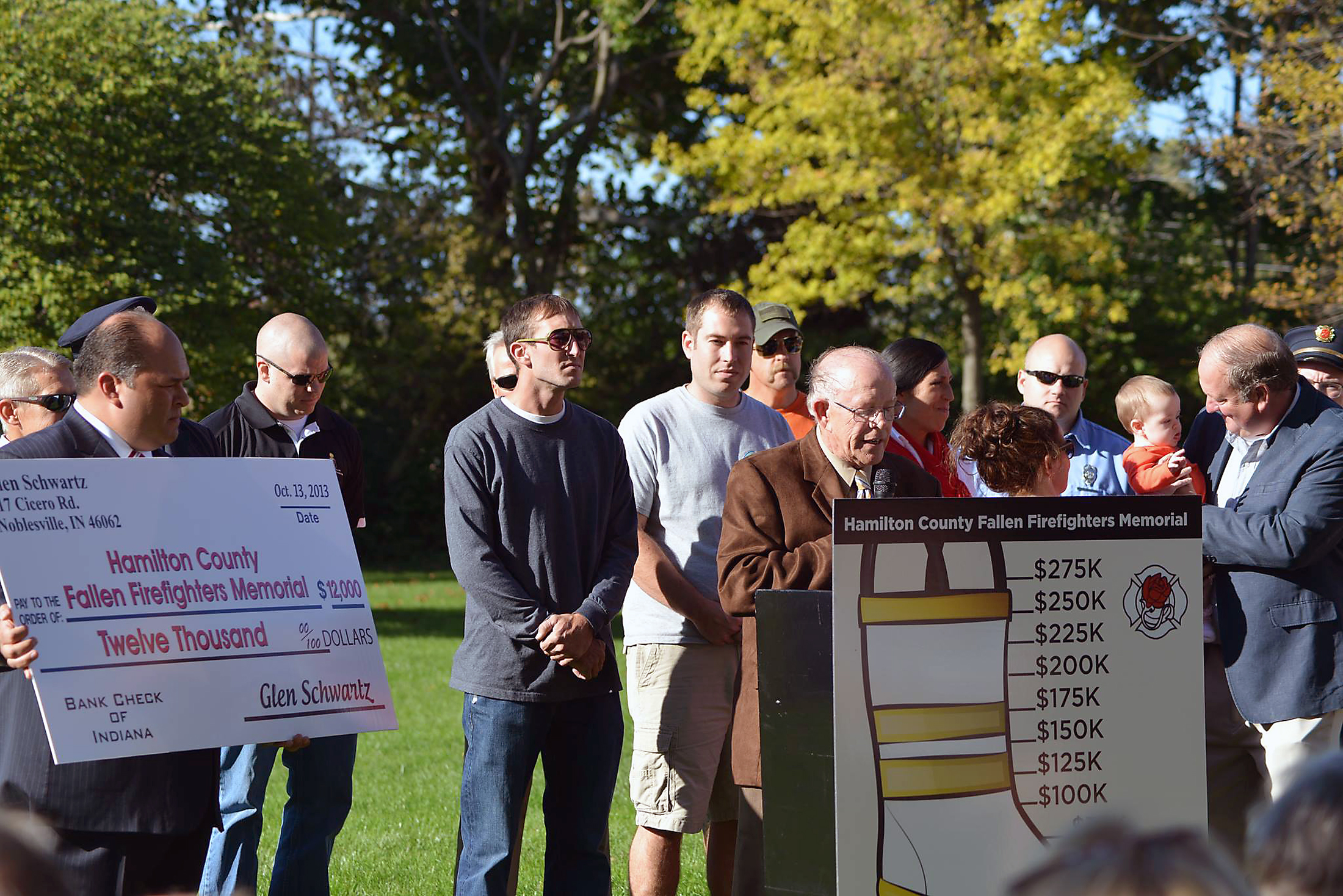 Surrounded by his family, Local 4416 President Tony Murray holds the $12,000 check presented by Glen Schwartz as he addresses the crowd on Oct. 13. (Submitted photo.)